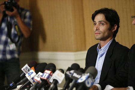 Plaintiff Michael Egan attends a news conference at the Four Seasons Hotel in Los Angeles, California