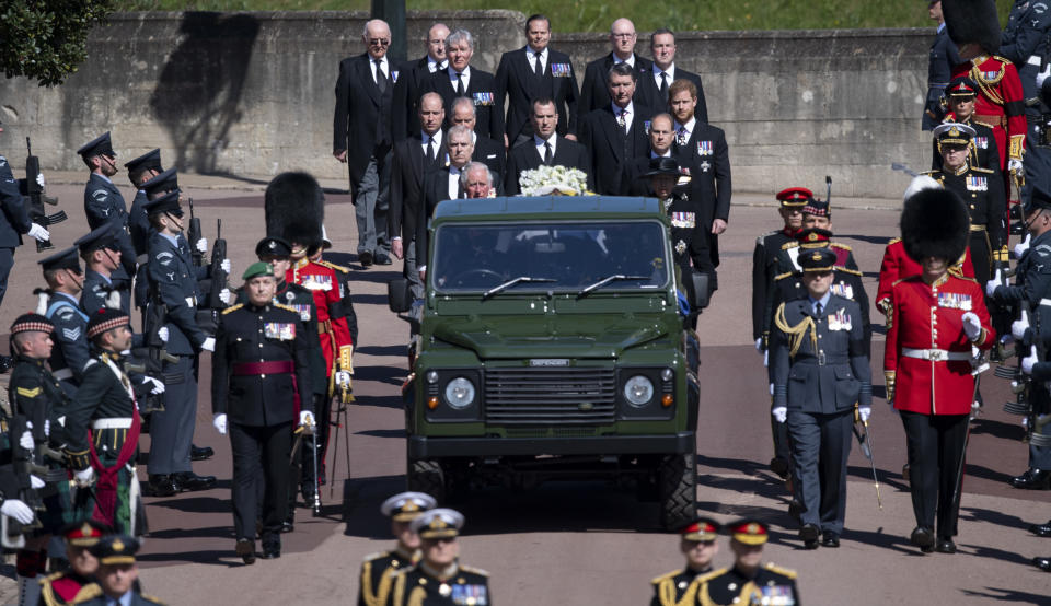 Prince Charles, Prince William, Prince Harry, Timothy Laurence, Princess Anne, Prince Andrew, Prince Edward, David, Earl of Snowdon, Peter Phillips walk behind a Land Rover carrying the coffin of Prince Philip at his funeral on April 17, 2021 in Windsor, England