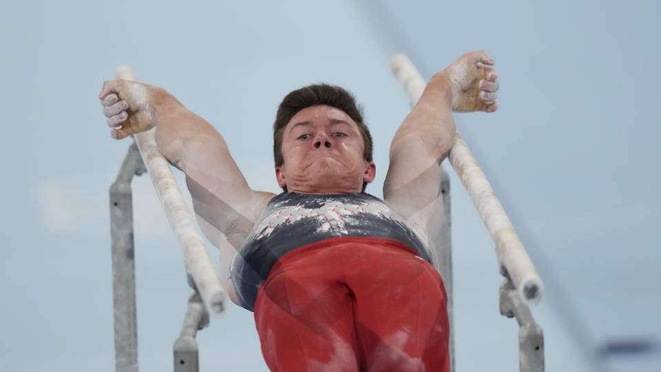 <p>Brody Malone, of the United States, performs on the parallel bars during the artistic gymnastics men's all-around final at the 2020 Summer Olympics, Wednesday, July 28, 2021, in Tokyo. (AP Photo/Gregory Bull)</p>