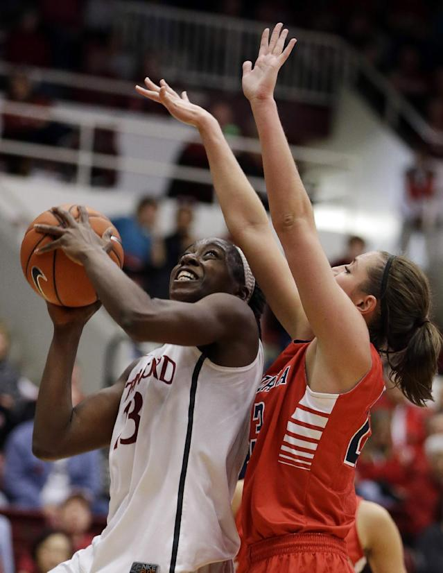 Stanford's Chiney Ogwumike, left, looks to shoot against Gonzaga's Kiara Kudron during the second half of an NCAA college basketball game Saturday, Dec. 14, 2013, in Stanford, Calif. (AP Photo/Ben Margot)