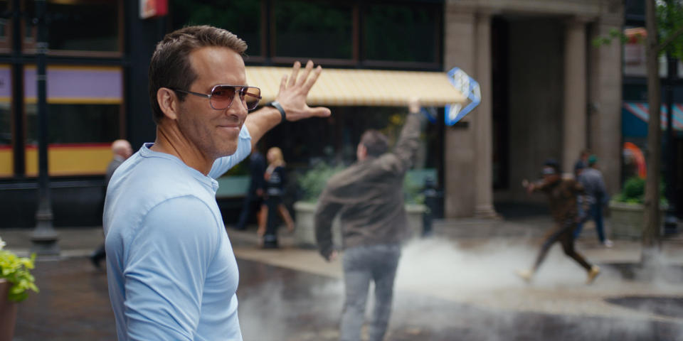 """This image released by 20th Century Studios shows Ryan Reynolds in a scene from """"Free Guy."""" (20th Century Studios via AP)"""