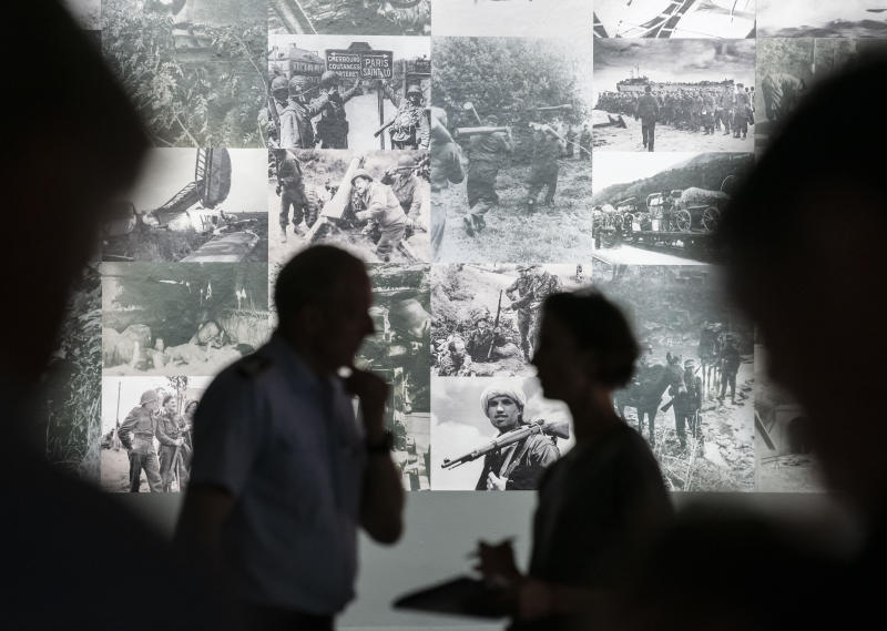 People stand in the exhibition during a press preview of the special exhibition 'The Fuehrer Adolf Hitler is dead - Attempted Assassination and coup d'etat on 20 July 1944.' by the Bundeswehr Museum of Military History in Dresden, Germany, Wednesday, July 3, 2019. The exhibition examines the background to the plot and shines a spotlight on 14 of the main conspirators. Some of the scenery used in the Hollywood movie Valkyrie and a photo collage provide visitors with a strong visual sense of these momentous events .The exhibition starts on July 5, 2019 and lasts until Dec. 3, 2019. (AP Photo/Jens Meyer)