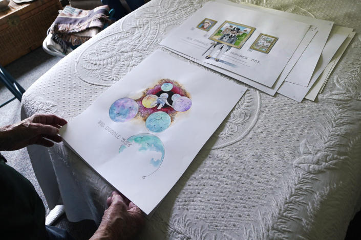 """Artist Robert Seaman reviews recent completed doodles in his room at an assisted living facility Monday, May 10, 2021, in Westmoreland, N.H. Seaman, who moved into the facility weeks before the COVID-19 pandemic shutdown his outside world in 2020, recently completed his 365th daily sketch, or what he calls his """"Covid Doodles"""", since being isolated due to the virus outbreak. (AP Photo/Charles Krupa)"""