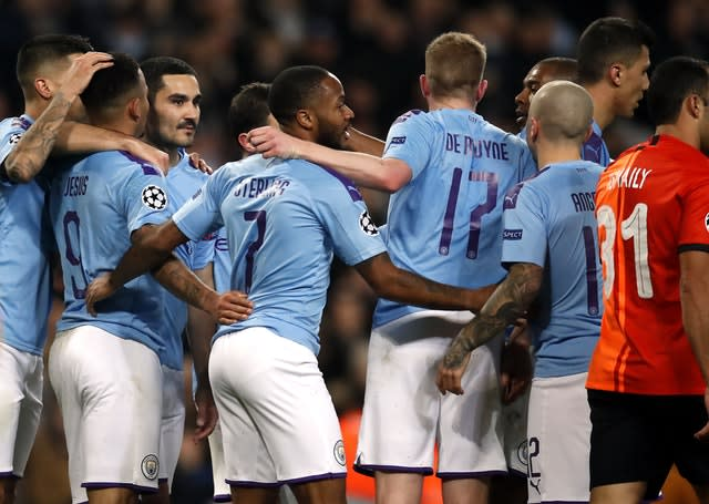 Manchester City celebrate a Champions League goal against Shakhtar Donetsk (Martin Rickett/PA).