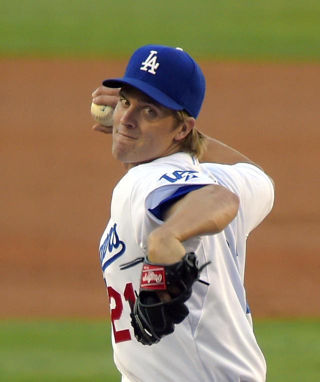 Los Angeles Dodgers starting pitcher Zack Greinke winds up during the second inning of a baseball game against the New York Mets, Saturday, Aug. 23, 2014, in Los Angeles. (AP Photo/Mark J. Terrill)