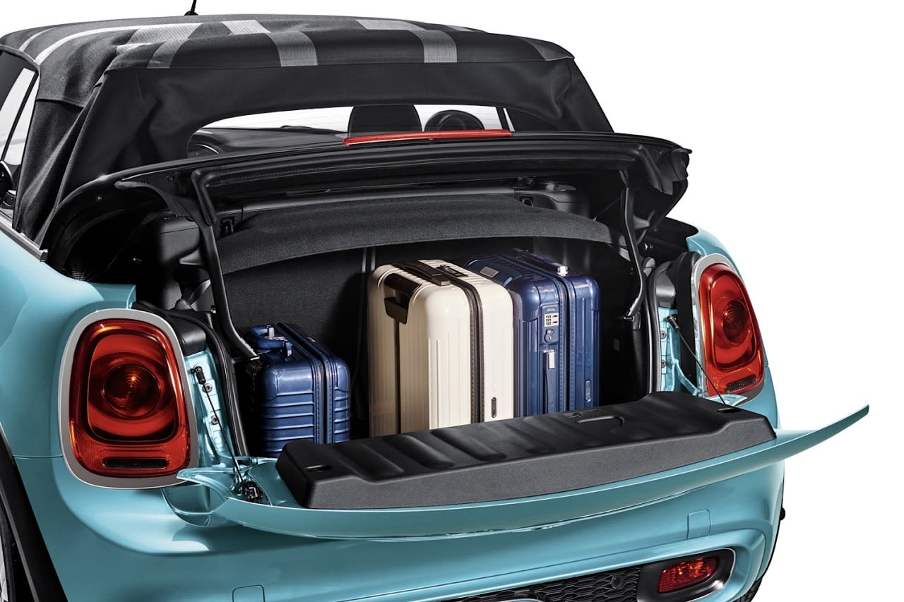 <p>The good news is that said luggage space is highly accessible, thanks to a flip-down tailgate (which can support 176 pounds) and a top stack that flips up a few inches to facilitate access. The rear seats also fold 50/50, should you have larger items to carry.</p>