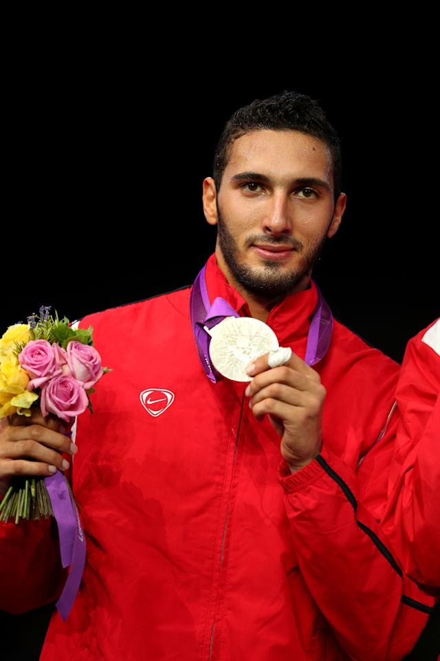 LONDON, ENGLAND - JULY 31:  Silver medallist Alaaeldin Abouelkassem of Egypt during the medal ceremony for the Men's Foil Individual on Day 4 of the London 2012 Olympic Games at ExCeL on July 31, 2012 in London, England.  (Photo by Hannah Johnston/Getty Images)