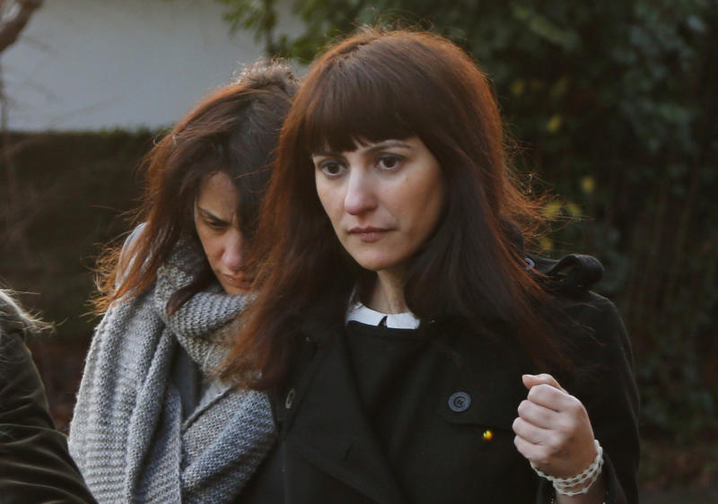 Italian sisters Francesca, right, and Elisabetta Grillo, left, former personal assistants of English broadcaster Nigella Lawson and her former husband art collector Charles Saatchi, arrive at the Isleworth Crown Court, in west London, Friday, Dec. 20, 2013, during a trial over alleged fraud. The Grillos are accused of committing fraud by abusing their positions as personal assistants by using a company credit card for personal gain between Jan. 1, 2008 and Dec. 31, 2012. (AP Photo/Lefteris Pitarakis)