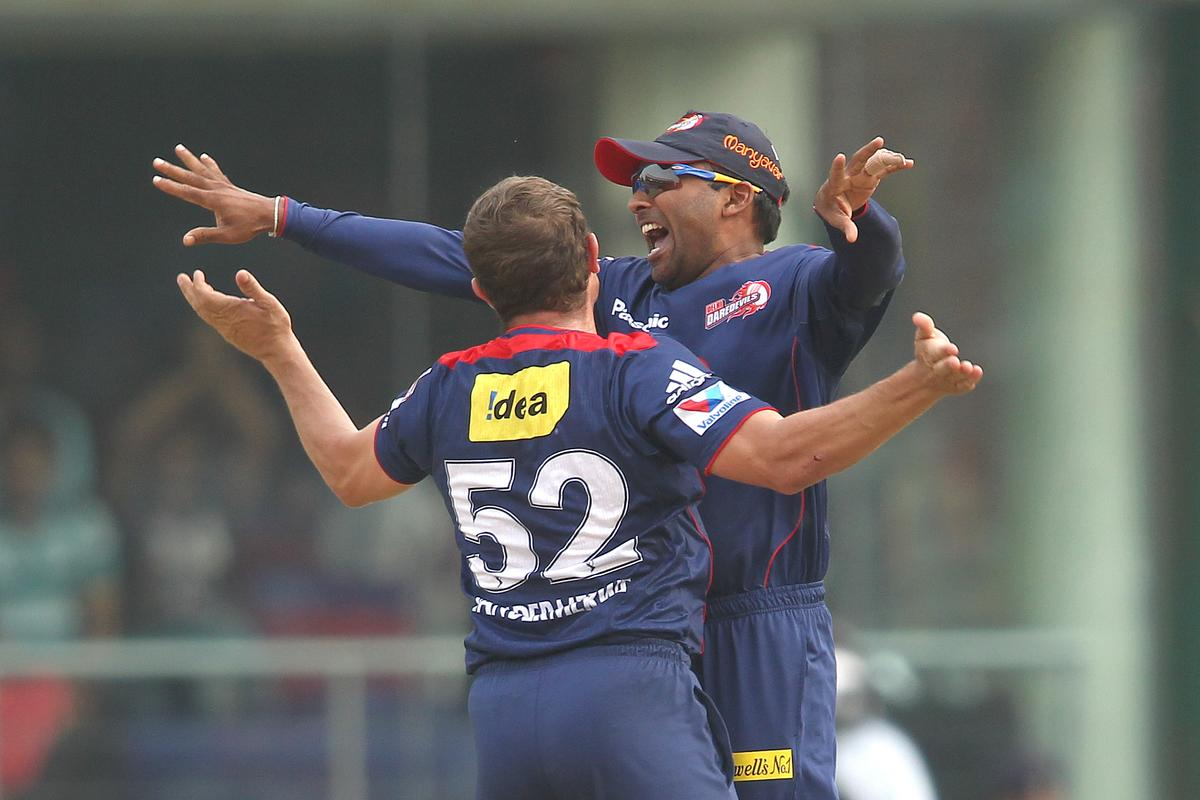 Roelof van der Merwe of Delhi Daredevils and Delhi Daredevils captain Mahela Jayawardene celebrate after getting Dwayne Smith of Mumbai Indians wicket during match 28 of the Pepsi Indian Premier League between The Delhi Daredevils and the Mumbai Indians held at the Feroz Shah Kotla Stadium, Delhi on the 21st April 2013..Photo by Shaun Roy-IPL-SPORTZPICS ..Use of this image is subject to the terms and conditions as outlined by the BCCI. These terms can be found by following this link:..https://ec.yimg.com/ec?url=http%3a%2f%2fwww.sportzpics.co.za%2fimage%2fI0000SoRagM2cIEc&t=1496057669&sig=nMbZ6p2yAO28cF91QRNyBQ--~C