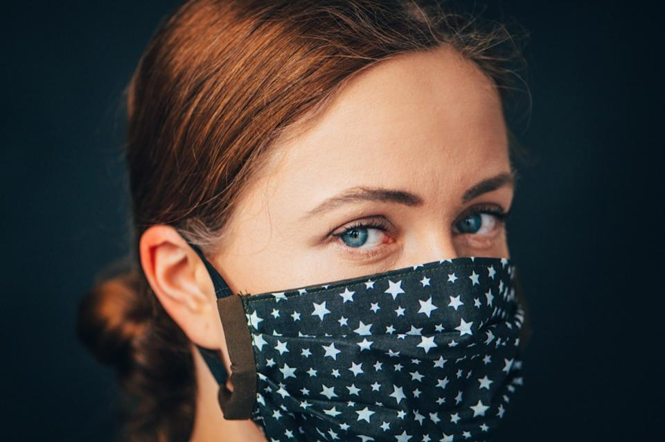 woman wearing star-print face mask