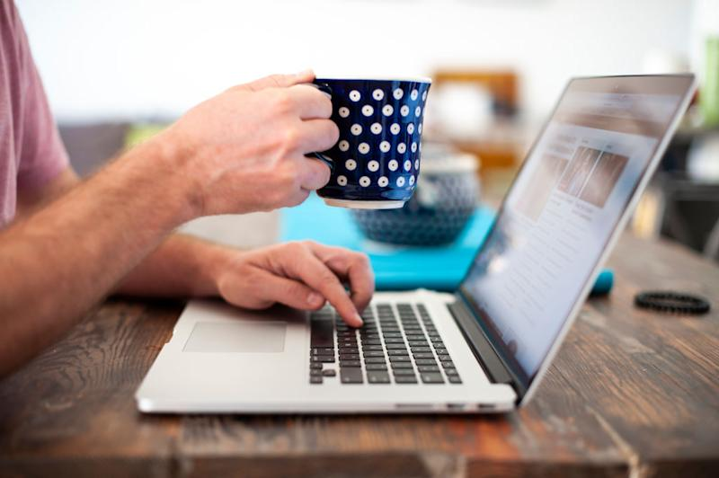 A computer user with a coffee mug. Source: Getty Images