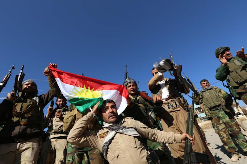 Iraqi autonomous Kurdish region's peshmerga forces and fighters from the Yazidi minority