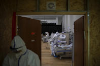 Medical personnel wearing protective equipment treat COVID-19 patients in an intensive care ward for coronavirus patients at Ziv Medical Center in the northern Israeli city of Safed, Sunday, Feb. 7, 2021. (AP Photo/Oded Balilty)