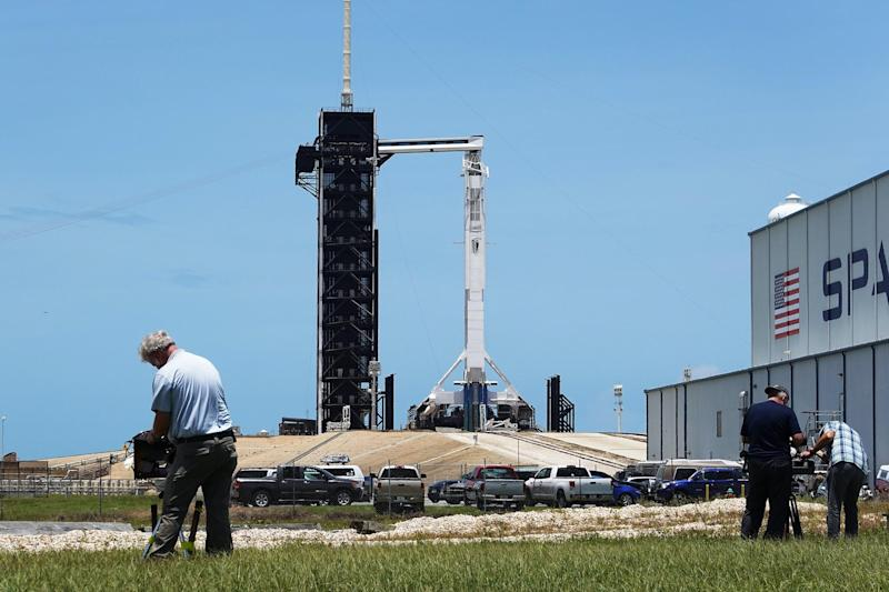 Photographers setup remote cameras as the SpaceX Falcon 9 rocket with the Crew Dragon spacecraft attached is seen on launch pad 39A at the Kennedy Space Center on May 29, 2020 in Cape Canaveral, Florida: Joe Raedle/Getty Images