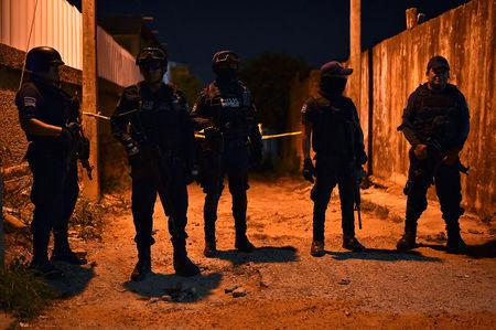 Police officers guard a crime scene where unidentified assailants opened fire at a bar in Minatitlan, in Veracruz state, Mexico, April 19, 2019. Picture taken April 19, 2019. REUTERS/Angel Hernandez