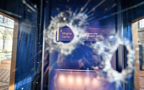 Hammer holes in the glass case that houses the Magna Carta inside the Chapter House - Credit: Ben Birchall/PA