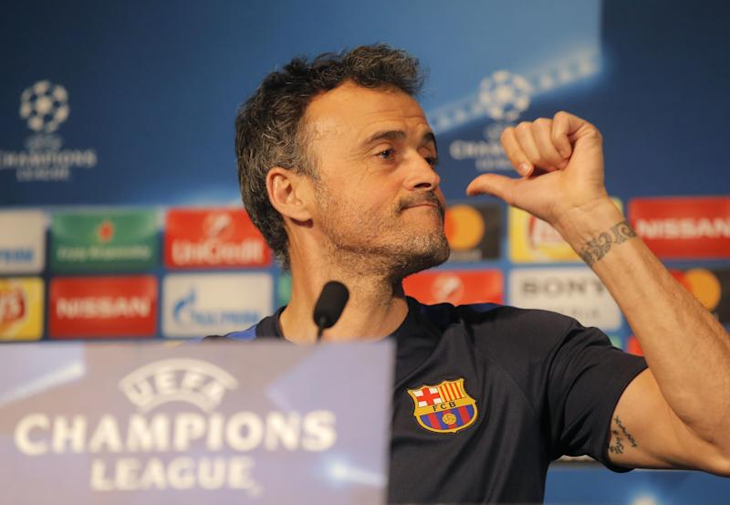 Barcelona's coach Luis Enrique gestures as he speaks during a press conference at the eve of the Champions League soccer match between Paris Saint Germain and Barcelona at the Parc des Princes stadium in Paris, Monday, Feb. 13, 2017. (AP Photo/Michel Euler)