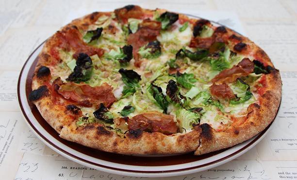 "<div class=""caption-credit""> Photo by: Tora B. Hennessey</div><div class=""caption-title""></div><b>Seattle: The Independent Pizzeria <br> <br></b> <i>Hanna Raskin, former food critic,</i> Seattle Weekly: ""Seattle is blessed with extraordinary pizza. Chalk it up to the local baking culture: If baking is a science and cooking is an art, it's no wonder the former thrives in the birthplace of Microsoft and Modernist Cuisine. So I have no quarrel with folks who cite Delancey, Serious Pie, or Via Tribunali as the source of their favorite pies. But I'm especially fond of the Independent Pizzeria, which pulls gorgeous crusts from its wood-fired brick oven. A tad thicker than the Neapolitan standard, the crust-speckled with char on its underbelly-has enough chew to sop up the Independent's robust tomato sauce, but doesn't wilt under the weight of spectacularly fresh toppings. I like the Brussels sprouts."" <br> <br>"