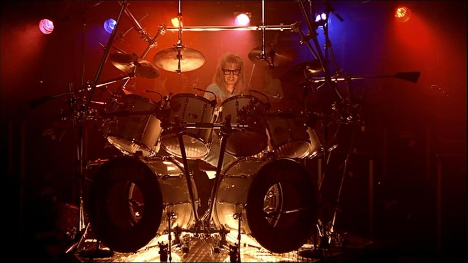 """<p>As Wayne is being denied his Stairway riff, Garth is getting busy on the drums, a skill we have hithero yet been party to. He starts off with a nervous tickle of a cymbal before launching into an epic minute-long drum solo, as stage lights dim and he becomes the star of the show. """"I like to play,"""" he says afterwards, meekly. (Credit: Paramount Pictures) </p>"""
