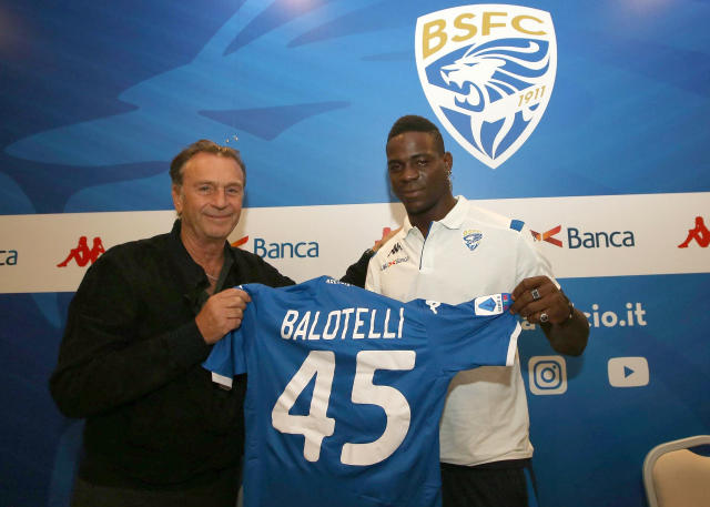FILE - In this Monday, Aug. 19, 2019 file photo, Brescia's president Massimo Cellino, left, holds a soccer jersey with soccer player Mario Balotelli during a press conference in Brescia, Italy. Brescia President Massimo Cellino has made an apparently racist remark about his own clubs forward Mario Balotelli. The 29-year-old Balotelli has struggled since returning to Serie A with Brescia, his hometown club, and was dropped from the weekends match following a dispute with coach Fabio Grosso. Asked about Balotelli on Monday, Cellino said: He's black, what can I say, hes working on clearing himself but hes having a lot of difficulty. (Filippo Venezia/ANSA via AP, File )