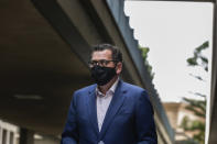 Premier of Victoria Daniel Andrews arrives for a news conference in Melbourne, Australia, Wednesday, Aug. 5, 2020. Victoria state, Australia's coronavirus hot spot, announced on Monday that businesses will be closed and scaled down in a bid to curb the spread of the virus. (AP Photo/Asanka Brendon Ratnayake)