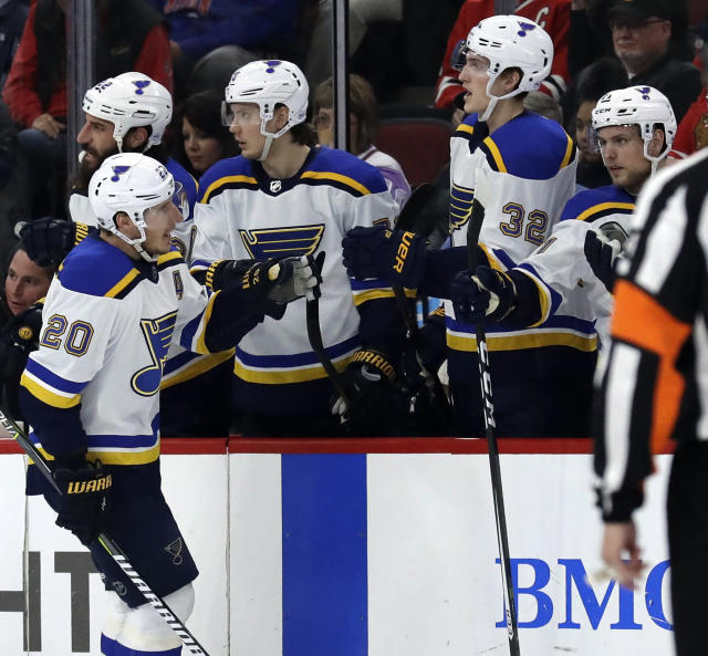 St. Louis Blues left wing Alexander Steen (20) celebrates with teammates after scoring his goal against the Chicago Blackhawks during the second period of an NHL hockey game Sunday, March 18, 2018, in Chicago. (AP Photo/Nam Y. Huh)