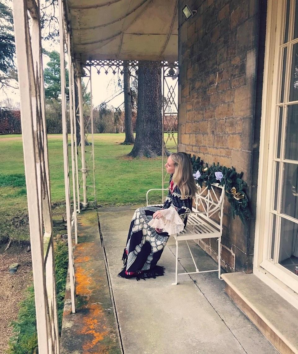 Sitting on our porch in my fave Gucci frock wondering if I've been good this year.