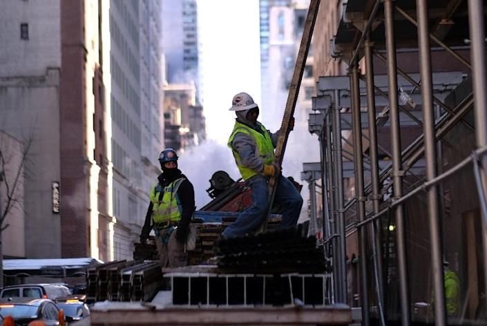The US Labor Department said 295,000 jobs were created in February, pushing the unemployment rate down to 5.5% (AFP Photo/Jewel Samad)