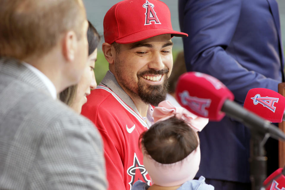 Los Angeles Angels' Anthony Rendon looks over at his 17-month-old daughter, Emma during a news conference to welcome him to the baseball team in Anaheim, Calif., Saturday, Dec. 14, 2019. (AP Photo/Alex Gallardo)