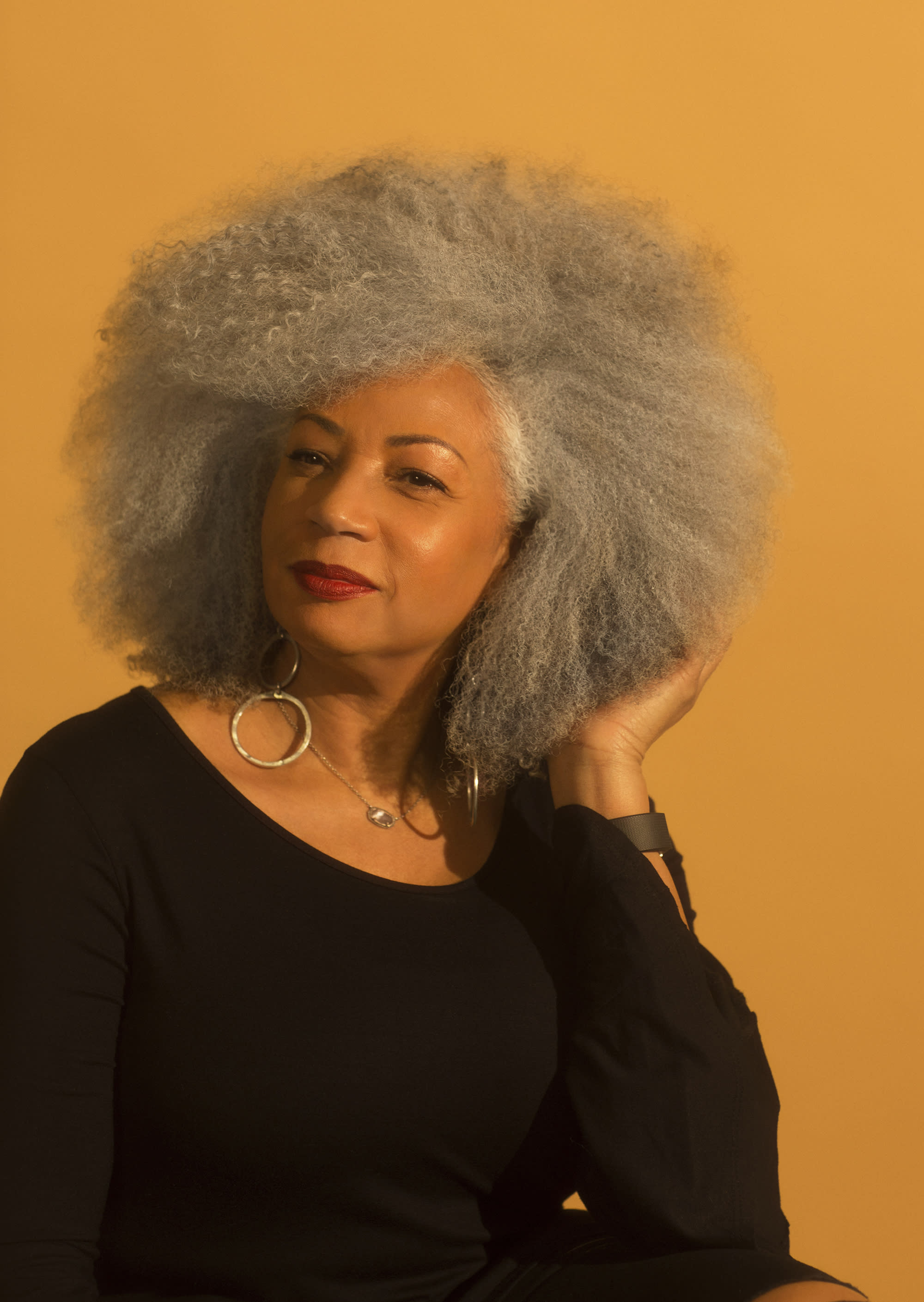 Mildred Bean, a life coach and social media influencer, is happy with her natural gray hair. (Photo: Natalia Mantini)