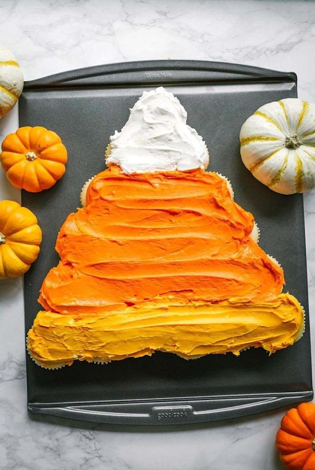 """<p>Don't be fooled by this candy corn-inspired treat—it's actually made of cupcakes. If you're hosting a lot of people, this pull-apart cake is a great idea.</p><p><strong>Get the recipe at <a href=""""http://www.goodcook.com/candy-corn-cupcake-cake/"""" target=""""_blank"""">Good Cook</a>.</strong></p><p><strong><a class=""""body-btn-link"""" href=""""https://www.amazon.com/Wilton-Non-Stick-Muffin-Cupcake-Baking/dp/B00KIFBI1C/?tag=syn-yahoo-20&ascsubtag=%5Bartid%7C10050.g.1366%5Bsrc%7Cyahoo-us"""" target=""""_blank"""">SHOP CUPCAKE TINS</a><br></strong></p>"""