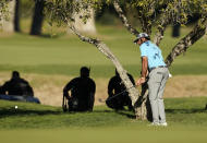 Max Homa hits his second shot from under a tree on the 10th hole during a playoff against Tony Finau in the final round of the Genesis Invitational golf tournament at Riviera Country Club, Sunday, Feb. 21, 2021, in the Pacific Palisades area of Los Angeles. (AP Photo/Ryan Kang)