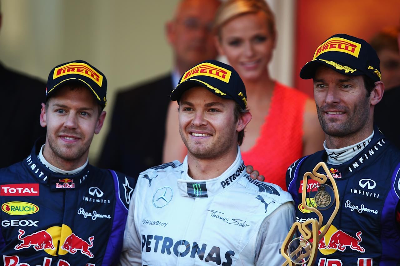 MONTE-CARLO, MONACO - MAY 26:  Race winner Nico Rosberg (C) of Germany and Mercedes GP celebrates with second placed Sebastian Vettel (L) of Germany and Infiniti Red Bull Racing and third placed Mark Webber (R) of Australia and Infiniti Red Bull Racing following the Monaco Formula One Grand Prix at the Circuit de Monaco on May 26, 2013 in Monte-Carlo, Monaco.  (Photo by Clive Mason/Getty Images)