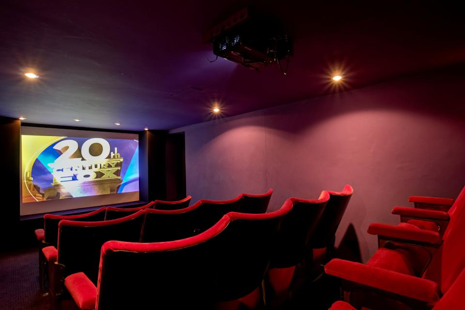 The manor house comes with its own retro cinema. (SWNS)