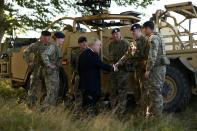 Britain's Prime Minister Boris Johnson meets with military personnel on Salisbury plain training area near Salisbury