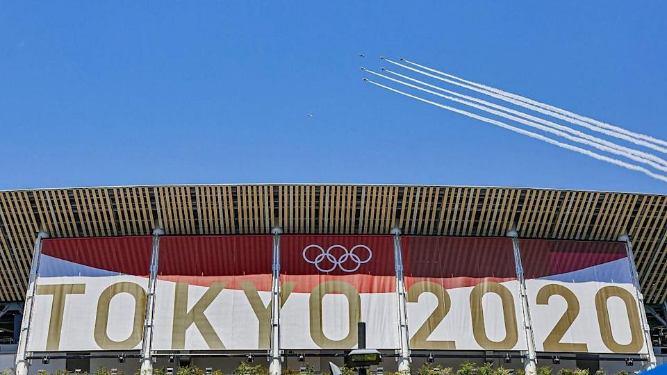 """<div class=""""paragraphs""""><p>Jet fly over Japan's National Stadium to mark the start of the 2020 Tokyo Olympics </p></div>"""