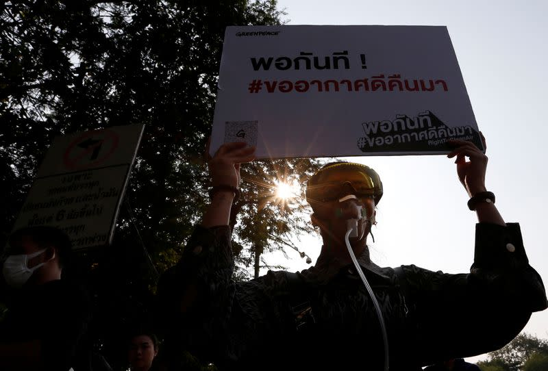 Environmental activists rally to demand rights to clean air, near the Thai Government House in Bangkok
