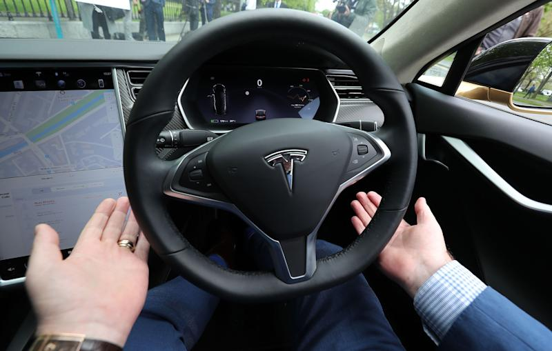 Dan Kiely, CEO of Voxpro, takes his hands off the wheel of his Tesla Model S car at a launch event for the MobilityX self-driving conference, a gathering of global autonomous vehicle leaders, in Dublin. (Photo by Niall Carson/PA Images via Getty Images)