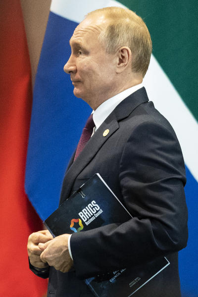 Russia's President Vladimir Putin leaves a meeting with members of the Business Council and management of the New Development Bank during the BRICS emerging economies at the Itamaraty palace in Brasilia, Brazil, Thursday, Nov. 14, 2019. (AP Photo/Pavel Golovkin, Pool)