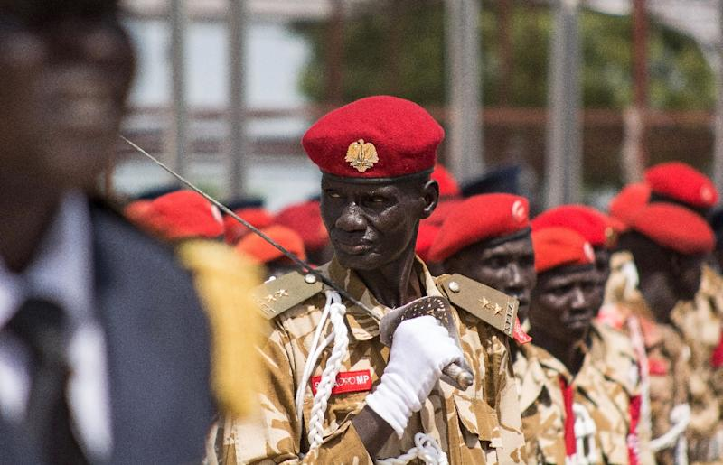 South Sudanese soldiers march during the 4th independence day celebrations of South Sudan at John Garang Memorial grounds in Juba on July 9, 2015 (AFP Photo/Charles Lomodong)