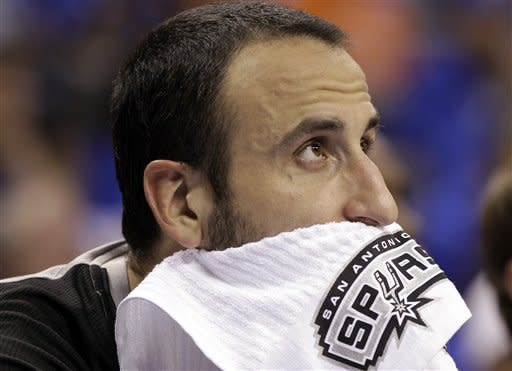 San Antonio Spurs shooting guard Manu Ginobili (20), of Argentina, watches action against the Oklahoma City Thunder during the first half of Game 3 in their NBA basketball Western Conference finals playoff series, Thursday, May 31, 2012, in Oklahoma City. (AP Photo/Eric Gay)