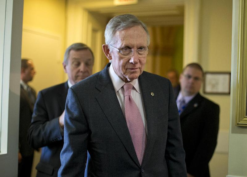 Senate Majority Leader Harry Reid of Nev., center, followed by Senate Majority Whip Richard Durbin of Ill., left, arrives for a news conference on Capitol Hill in Washington, Thursday, Nov. 29, 2012, following a meeting with Treasury Secretary Timothy Geithner on the fiscal cliff negotiations. (AP Photo/J. Scott Applewhite)