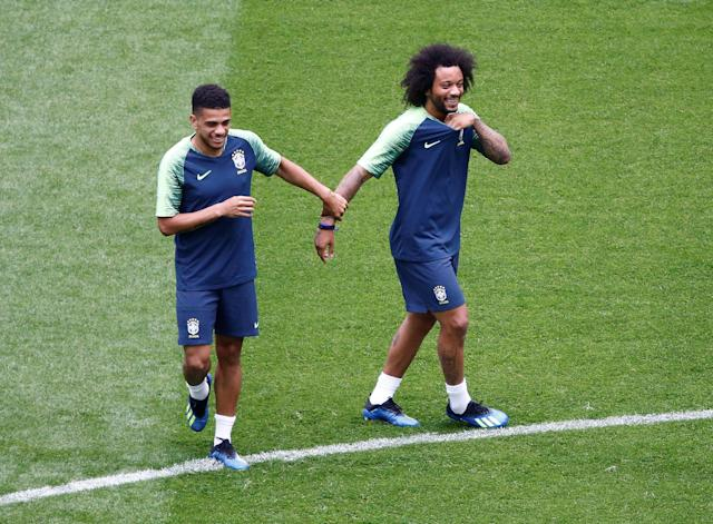 Soccer Football - World Cup - Brazil Training - Saint Petersburg Stadium, Saint Petersburg, Russia - June 21, 2018 Brazil's Taison and Marcelo during training REUTERS/Anton Vaganov