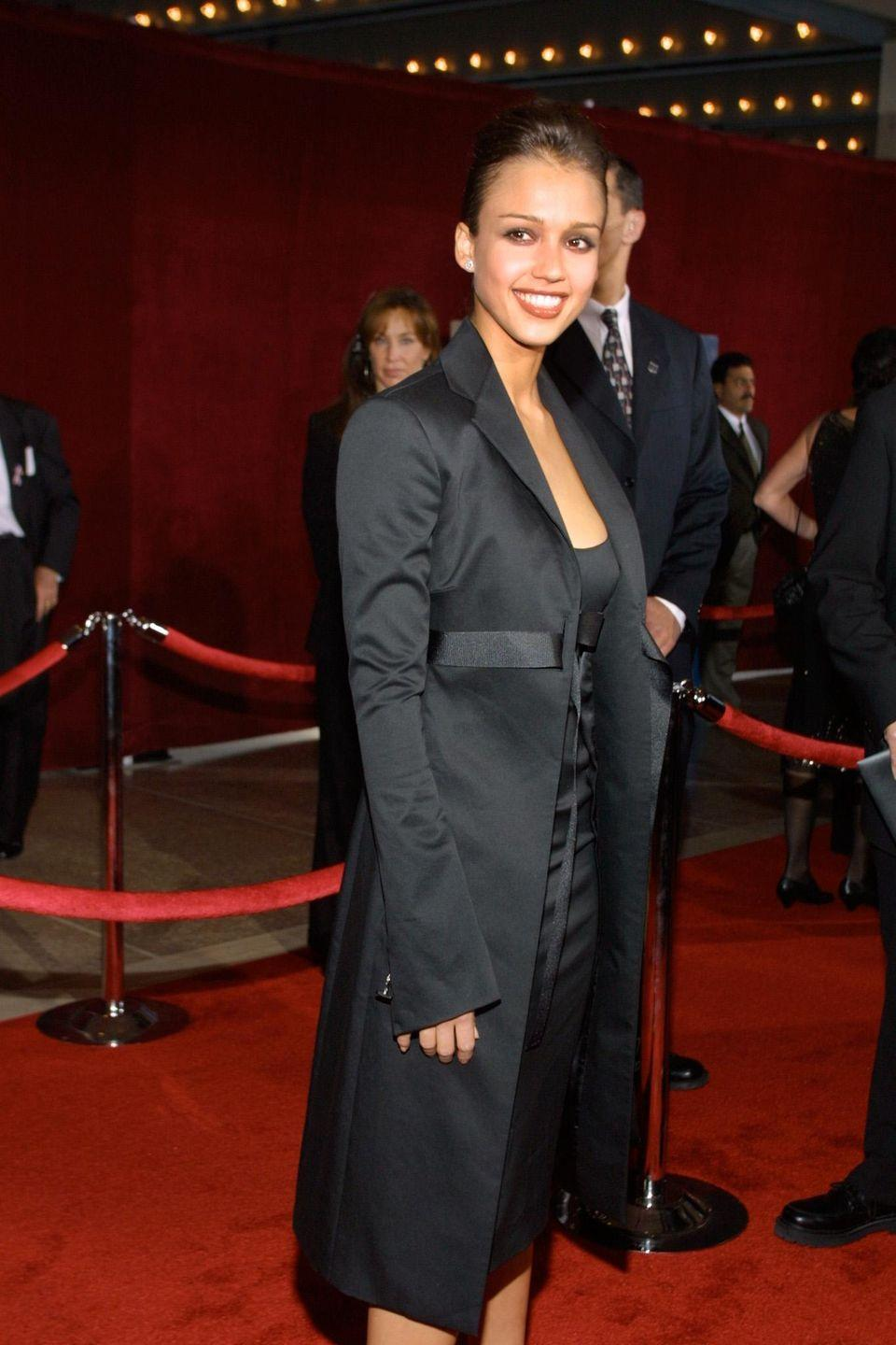 <p>She kept it classic with a long black jacket and knee-length LBD underneath. </p>