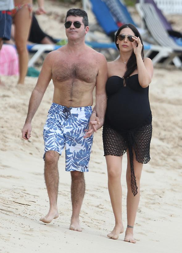 Simon Cowell and pregnant girlfriend Lauren Silverman are pictured at the beach while on holiday in Barbados. The couple held hands and chatted with a local wool artist and took time to pose and take pictures with fans.<P>Pictured: Simon Cowell and Lauren Silverman<P><B>Ref: SPL673168  261213  </B><BR/>Picture by: PRIMADONNA/GEMAIRA/Splash News<BR/></P><P><B>Splash News and Pictures</B><BR/>Los Angeles:310-821-2666<BR/>New York:212-619-2666<BR/>London:870-934-2666<BR/>photodesk@splashnews.com<BR/></P>