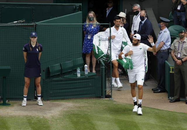 The players walk out on Centre Court to applause
