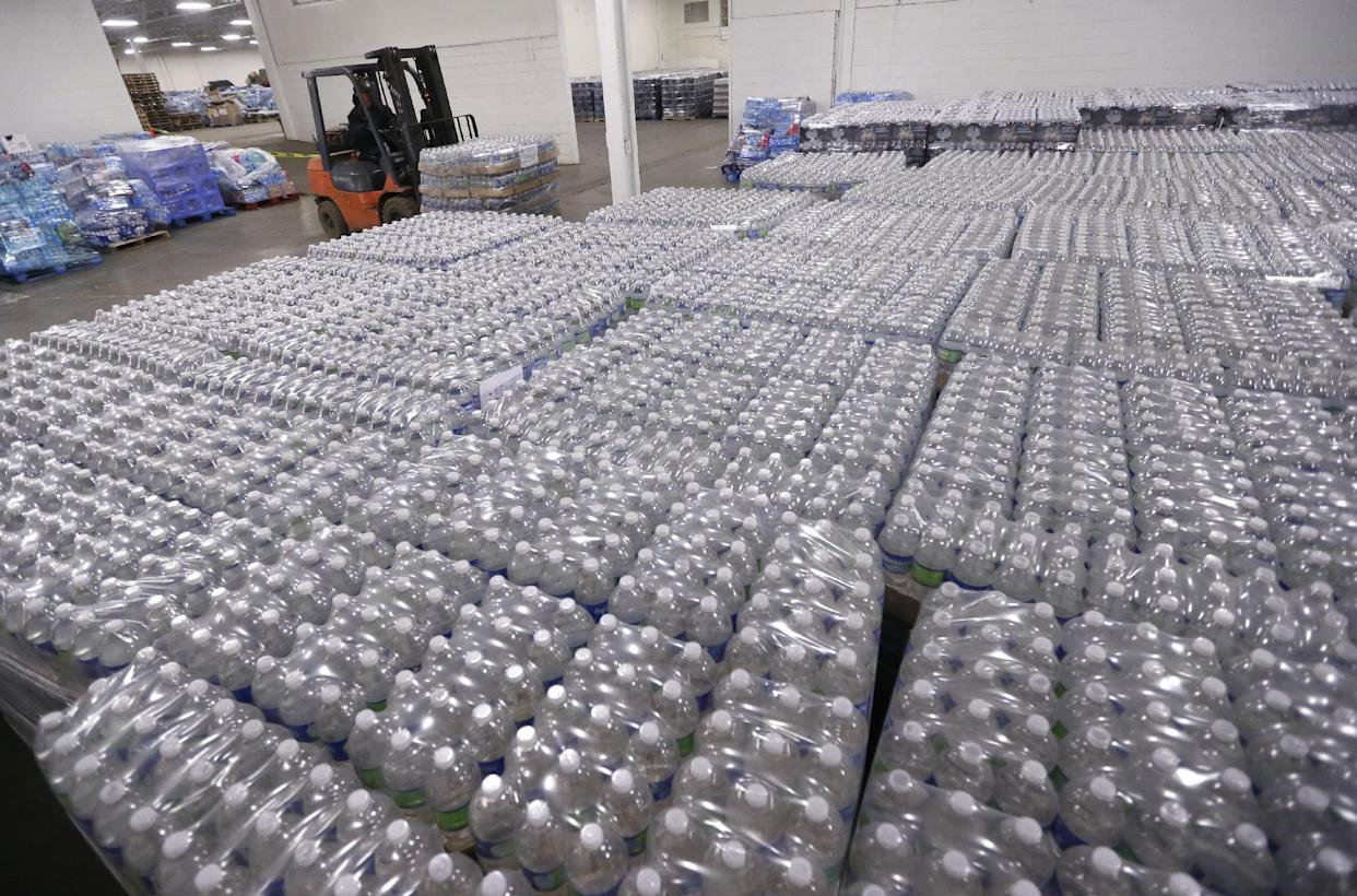 A forklift driver moves a pallet of water in a warehouse for residents of Flint, Michigan. (Carlos Osorio/AP Photo)