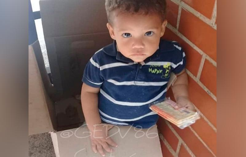 Venezuela toddler found abandoned, dumped in a cardboard biscuit box outside flats.