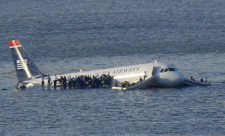 Passengers stand on the wings of a US Airways plane after it landed in the Hudson River near New York City, Jan. 15, 2009.