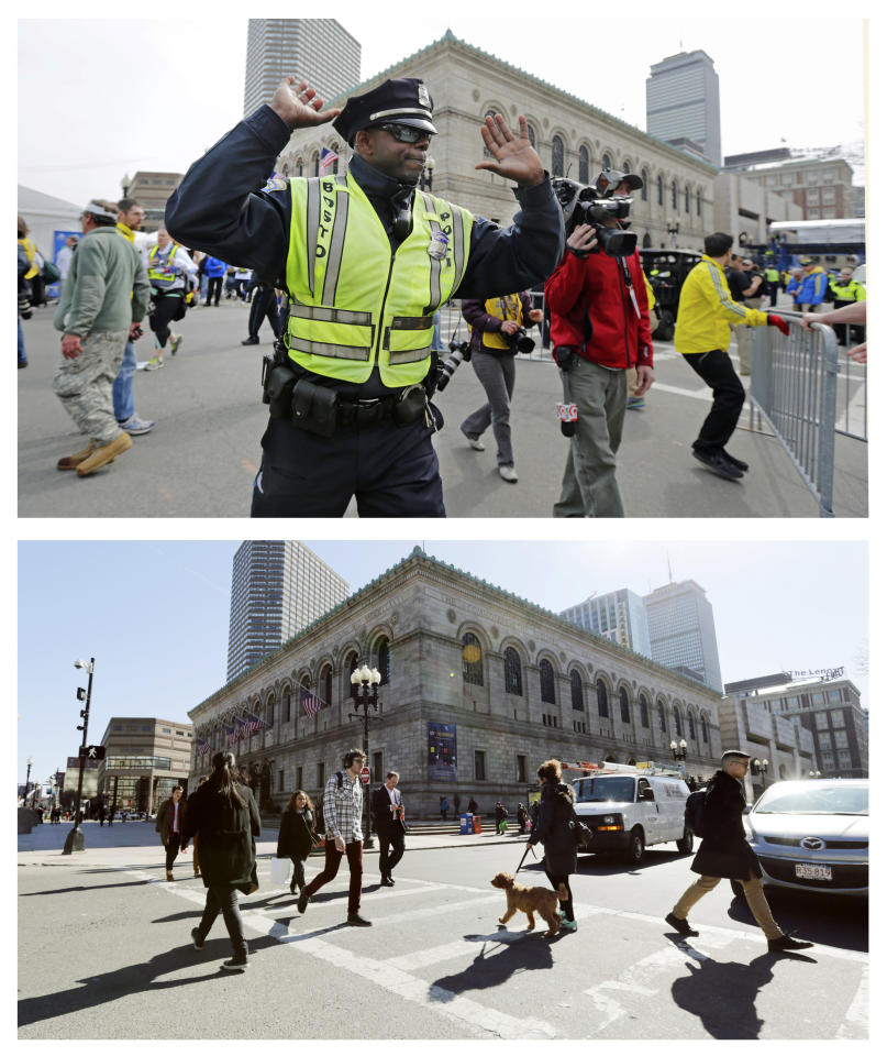 This combination of April 15, 2013 and April 2, 2014 photos show a police officer clearing Boylston Street following a bomb blast near the finish line of the 2013 Boston Marathon, and pedestrians crossing at the same corner nearly a year later in Boston. (AP Photo/Charles Krupa)
